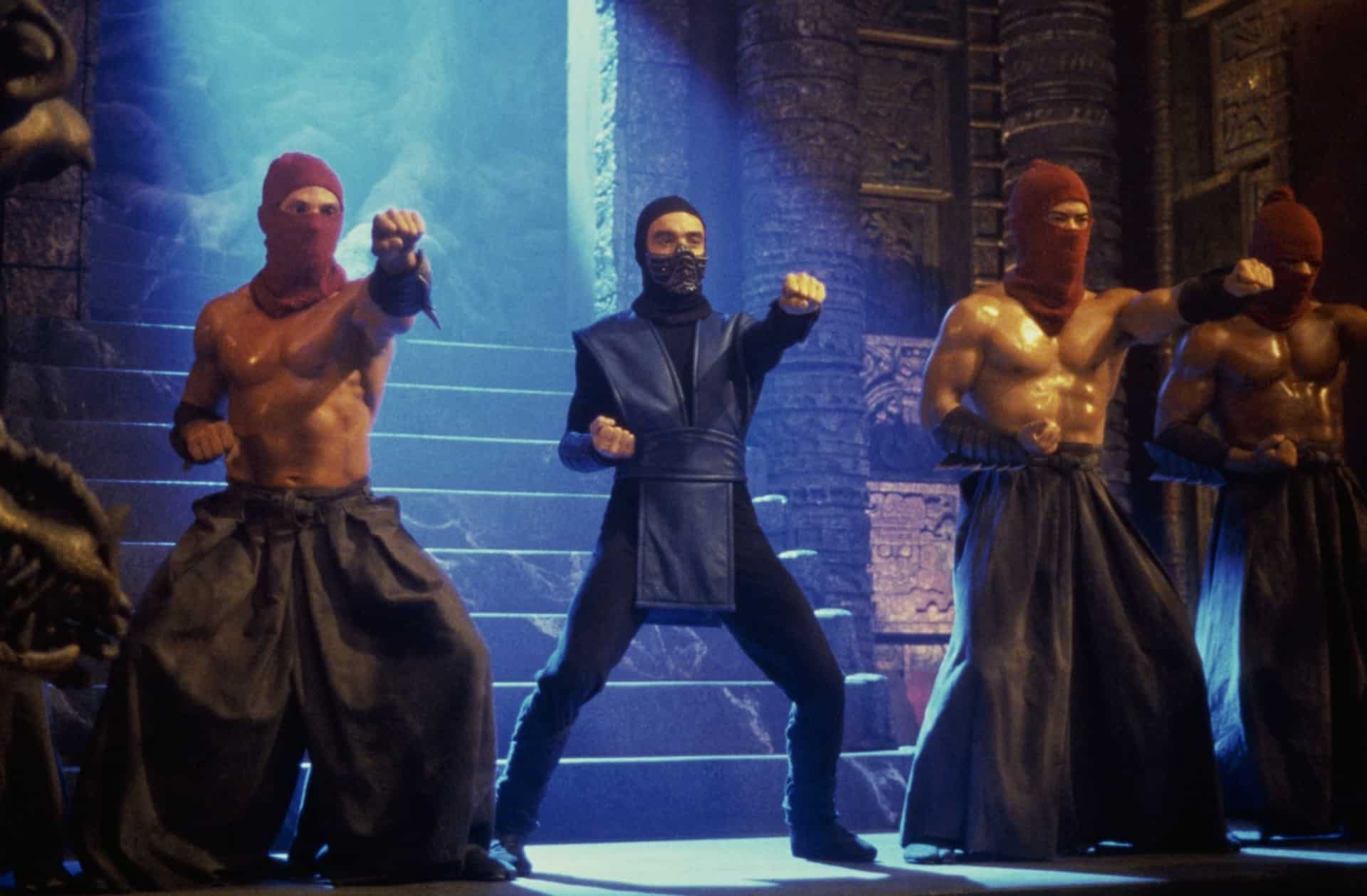 Live action Sub-Zero striking a martial arts pose with three other men.