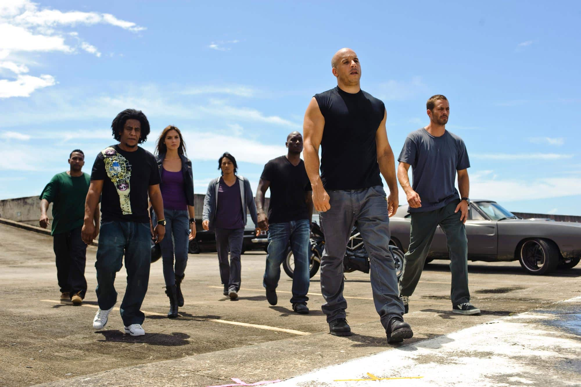 Fast Five exists at center of Fast & Furious franchise, in-between grounded human entries and insane action blockbuster physics-breaking spectacle