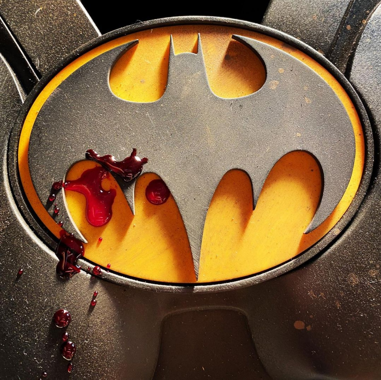 Blood and the bat symbol: The Michael Keaton Batman Batsuit gets bloody in this teaser image for The Flash shared by director Andy Muschietti.